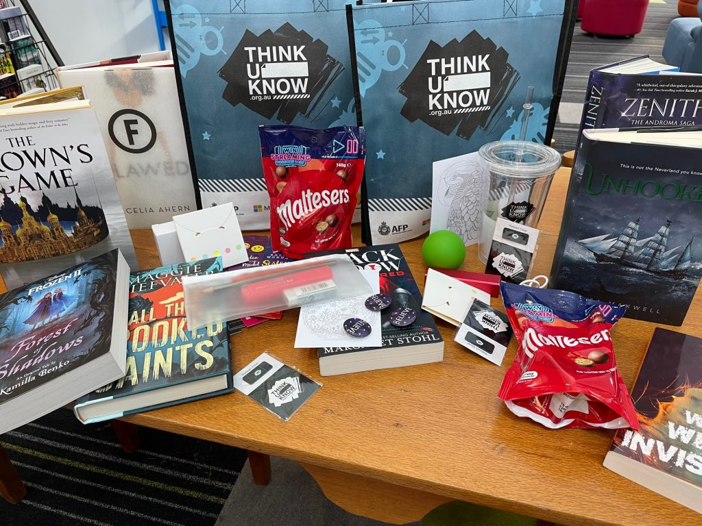 Prizes including chocolates, books and bags displayed on a table