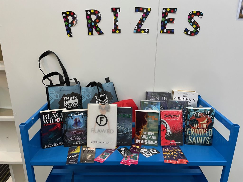 Prizes displayed on a trolley with the word prizes above